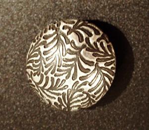 Temp-MetalLentil1-300x262